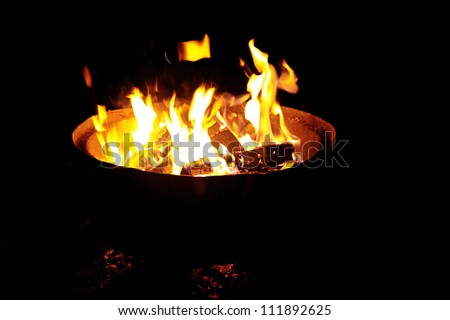 Fire in outdoors fire pit - Camp fire
