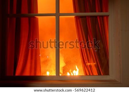 Fire in the house - Shutterstock ID 569622412