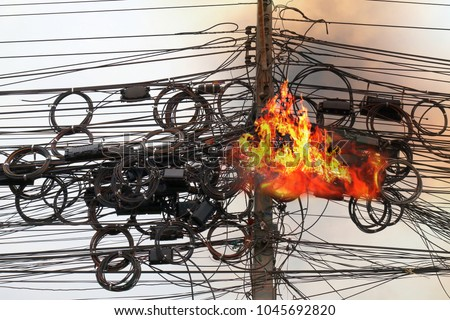 Fire is burning at High Voltage Cables power, Danger wire tangle cord electrical energy