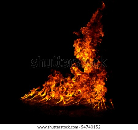 Fire isolated on black background - stock photo