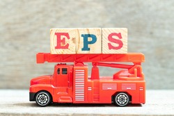 Fire ladder truck hold letter block in word EPS (Abbreviation of Earnings per share) on wood background