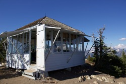 Fire lookout on a snow covered mountain