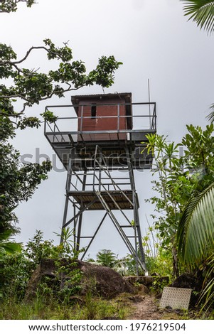 Fire observation tower built at the top of Mont Azore (Fond Azore), on Glacis Noire nature trail, highest peak of Praslin Island, Seychelles. Lush vegetation around.  Photo stock ©