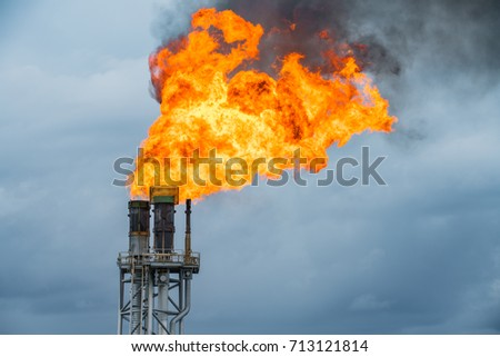 Fire on flare stack at oil and gas central processing platform while burning toxic and release over pressure from process. #713121814