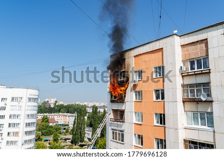 fire on the balcony of a multi-storey building, black clouds of smoke, apartment smoke, extinguishing fire in a residential building, fire escape, emergency