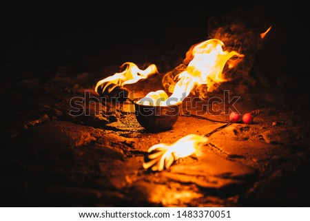 Fire poi performance. Burning poi / torch on the ground Photo stock ©