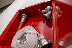 Fire protection cabinet with fire hydrant and hose. It's in the store.