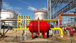Fire protection system with bladder tank ,yellow and red piping work on storage tank background, safety concept.