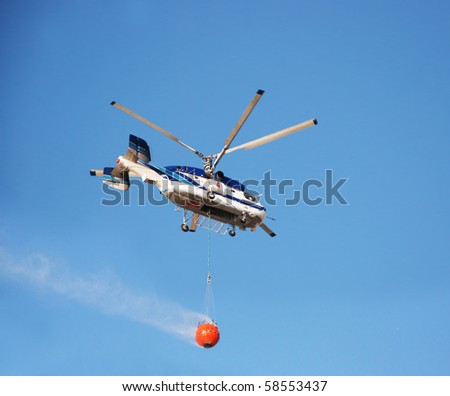 Fire rescue helicopter with water bucket
