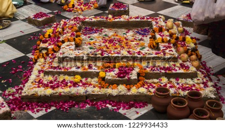 Fire sacrifice alter, or yajnakunda decorated with flowers and colours. #1229934433