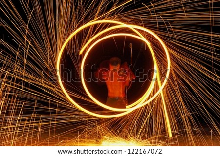 Fire show a circular motion. Fire show amazing at night