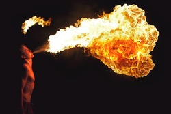 Fire show artist breathe fire in the dark