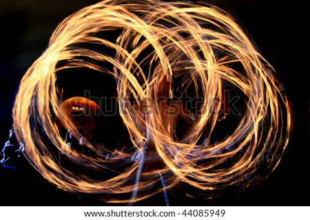 Fire-show man in action with fire