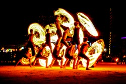 Fire show on the beach and watching the fireworks.Fireworks light up the air with dazzling display of fire.Men spin the fire among people.Reputation show of fire since full moon party held.
