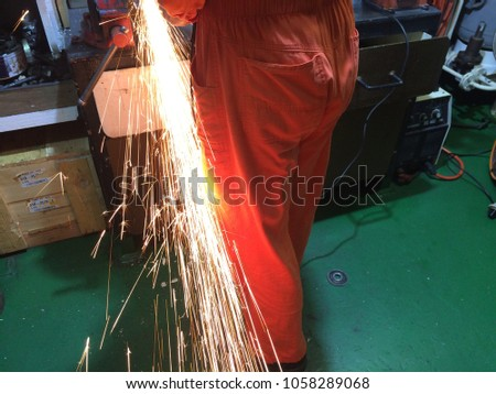fire sparks while cutting metal, fire sparks while burning element #1058289068