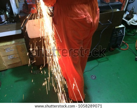 fire sparks while cutting metal, fire sparks while burning element #1058289071