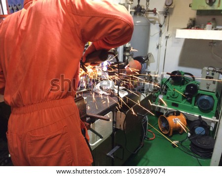 fire sparks while cutting metal, fire sparks while burning element #1058289074