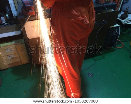 fire sparks while cutting metal, fire sparks while burning element #1058289080