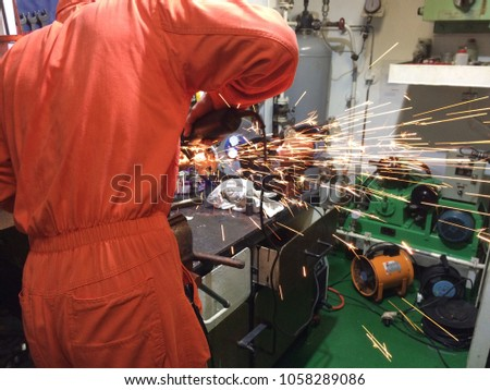 fire sparks while cutting metal, fire sparks while burning element #1058289086