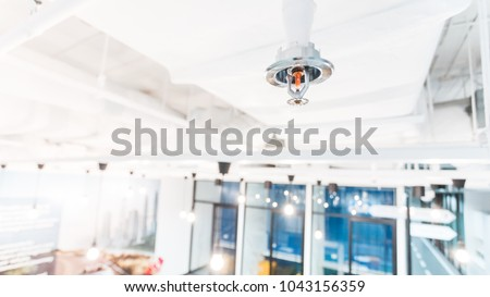 Fire Sprinkler in office building blur background., focus at selective - Shutterstock ID 1043156359