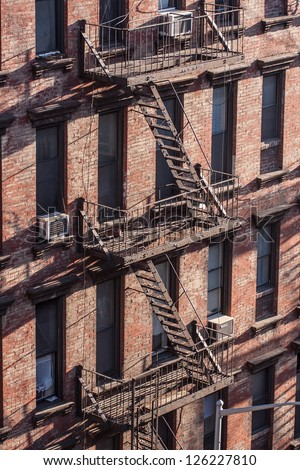 Fire steps on front brick building in Brooklyn, New York.