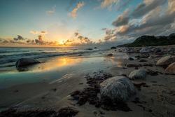 fire sunrise on the sea beach, rocky shore