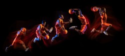 Fire tail or ways. African-american young basketball player of red team in action and neon lights over dark studio background. Concept of sport, movement, energy and dynamic, healthy lifestyle.