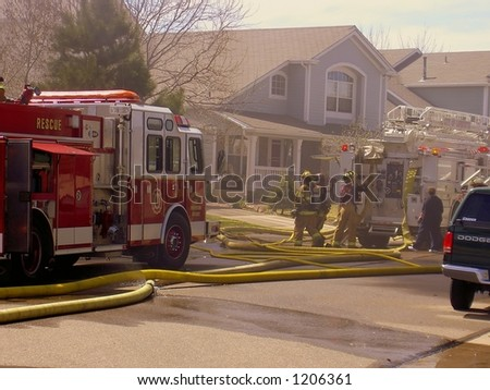 Fire truck and firemen at scene of house fire #5