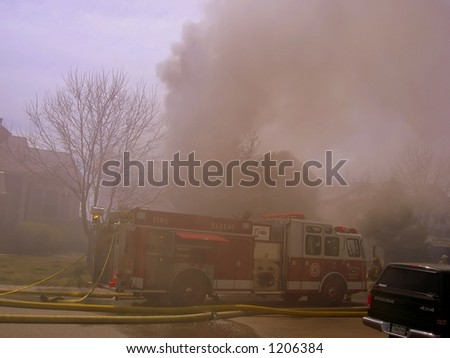 Fire truck and firemen at scene of house fire #28
