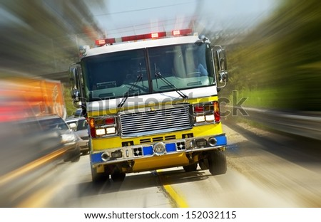 Fire Truck in Action - California, USA. Fire Department at Work. Flashing Lights of Fire Truck. Transportation Collection.