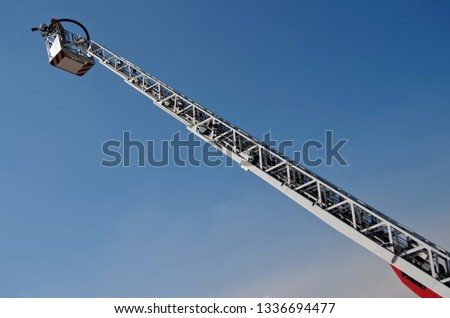 Fire truck lift in the blue sky. Putting out fires and saving people. Mechanisms and devices #1336694477
