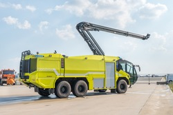 Fire truck on the airport runway with equipment for firefighting operations