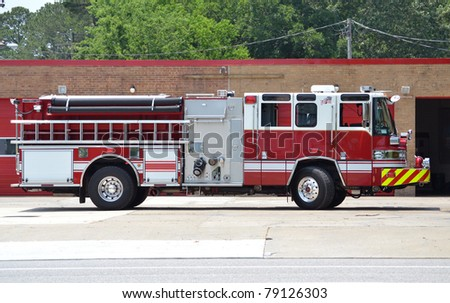fire truck parked at a fire station