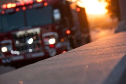 Fire truck pulls up to the scene of an accident at sunset