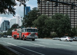 Fire Truck speeds through intersection en route to an emergency.