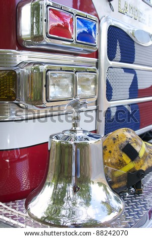 fire truck with bell and hat on the bumper