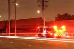 Fire Truck with Lights on at Night
