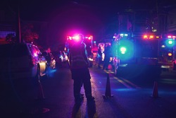 Fire trucks and unrecognizable first responders at scene of night accident