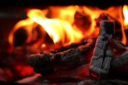 Fire wood coal amber ash closeup