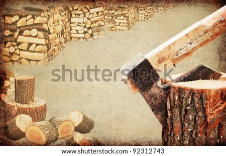 Fire wood concept.Close detail of an old and rusty axe chopping wooden log
