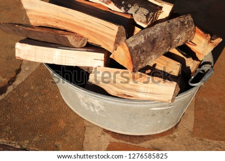 Fire wood in a steel container. Fire making concept image.