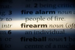 firearm word in a dictionary. firearm concept, definition.
