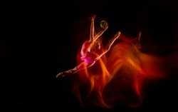 Fireball. Young flexible girl isolated on black studio background in mixed light. Female rhythmic gymnastics artist practicing in action. Exercises for flexibility, balance. Grace in motion, sport.