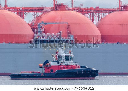 FIREBOAT AND TANKER-  Gas Carrier safety secured by fireboat at the gas terminal in the port of Swinoujscie (Poland)  - Shutterstock ID 796534312