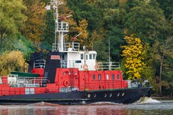 FIREBOAT - Ship is sailing along the canal against the background of autumn trees