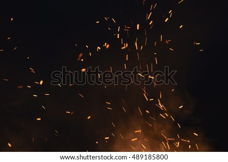 firecamp sparks over night sky, black background #489185800