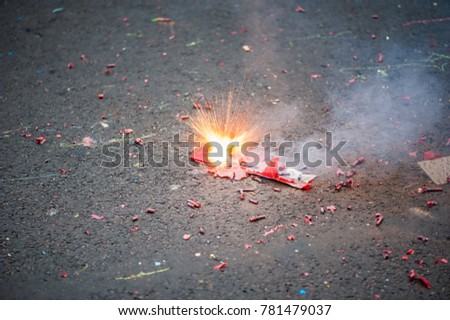 Firecracker exploding in the street for the chinese new year celebration #781479037