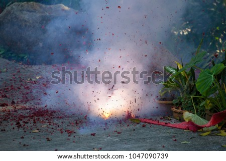 Firecrackers, burnt firecrackers lying on the street in Thailand . Close up #1047090739