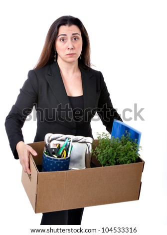 fired business woman carrying her personal stuff