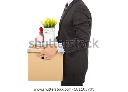 fired businessman carrying his belongings - stock photo